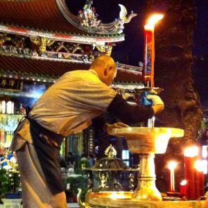 Polishing the candlesticks inside Longshan Temple